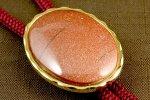 ループタイ 金色フレーム付き 茶金石