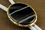 ループタイ 金色フレーム付き 縞オニキス