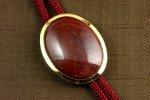 ループタイ 金色フレーム付き 赤玉石