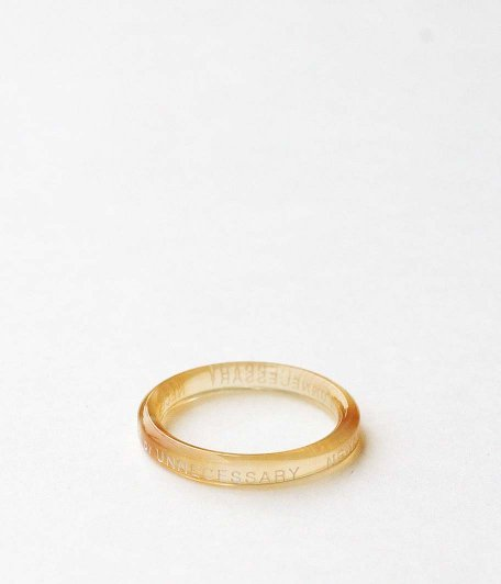 NECESSARY or UNNECESSARY BUTTON RING 2 INK [AMBER]
