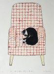 赤い格子縞の椅子と黒ねこ