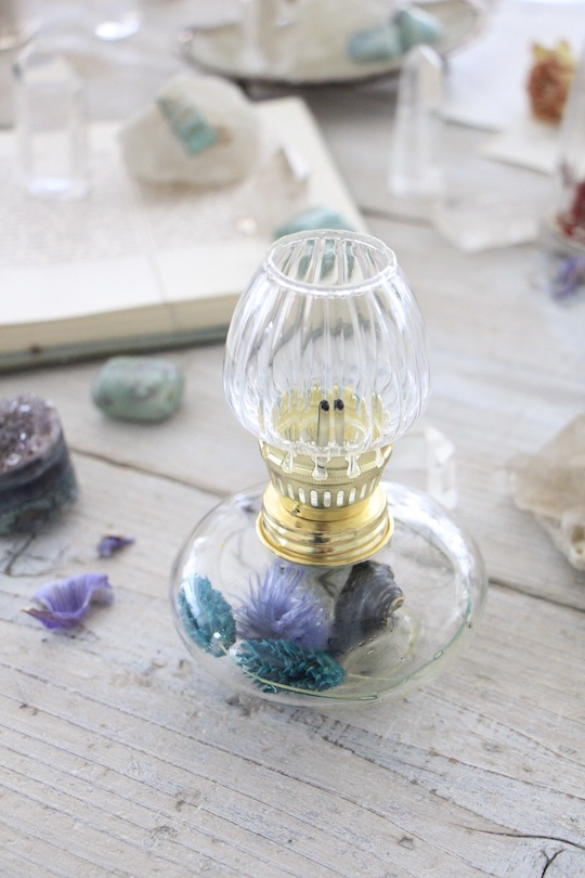 oil lamp =blue dry flower=