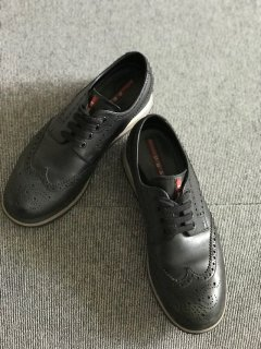 PRADA wingtip leather sneaker 4E